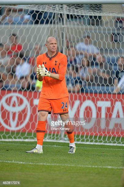 Goalkeeper Brad Friedel of Tottenham Hotspur claps during the first half against the Chicago Fire at Toyota Park on July 26 2014 in Bridgeview...
