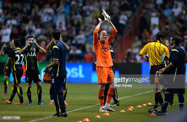 Goalkeeper Brad Friedel of Tottenham Hotspur claps for fans as he is subbed out of the game during the second half against the Chicago Fire at Toyota...