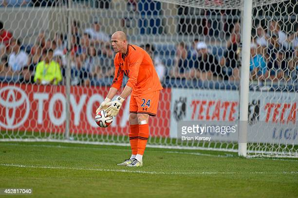 Goalkeeper Brad Friedel of Tottenham Hotspur handles the ball during the first half against the Chicago Fire at Toyota Park on July 26 2014 in...