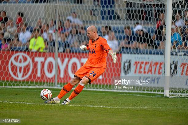 Goalkeeper Brad Friedel of Tottenham Hotspur kicks the ball during the first half against the Chicago Fire at Toyota Park on July 26 2014 in...