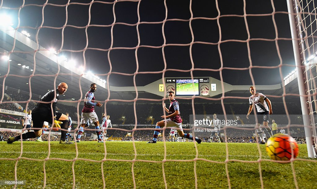 Goalkeeper Brad Guzan of Aston Villa looks on as Dele Alli of Tottenham Hotspur (C) scores their second goal during the Barclays Premier League match between Tottenham Hotspur and Aston Villa at White Hart Lane on November 2, 2015 in London, England.