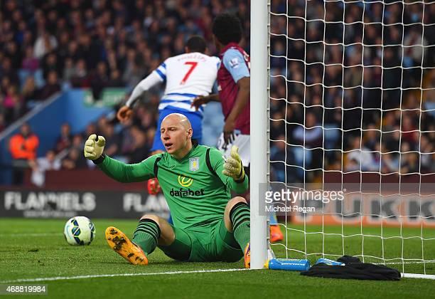 Goalkeeper Brad Guzan of Aston Villa reacts as Matt Phillips of QPR scores their first goal during the Barclays Premier League match between Aston...