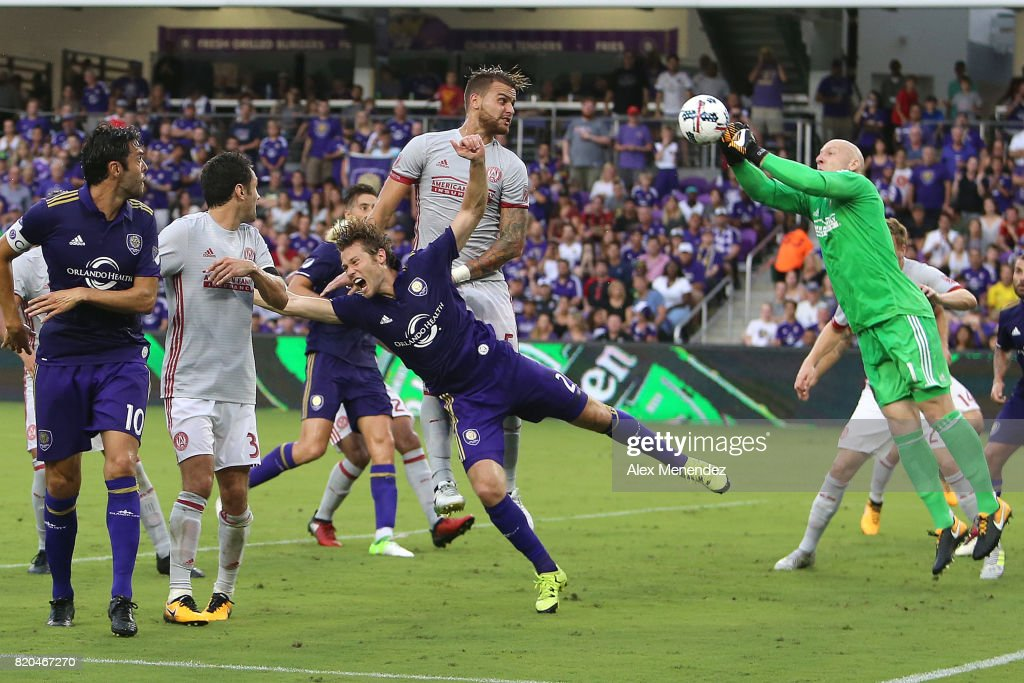 Goalkeeper Brad Guzan #1 of Atlanta United makes a save against Jonathan Spector #2 of Orlando City SC during a MLS soccer match between Atlanta United FC and the Orlando City SC at Orlando City Stadium on July 21, 2017 in Orlando, Florida.