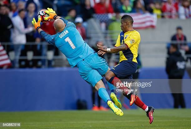 Goalkeeper Brad Guzan of the United States battles Michael Arroyo of Ecuador during the 2016 Quarterfinal - Copa America Centenario match at...