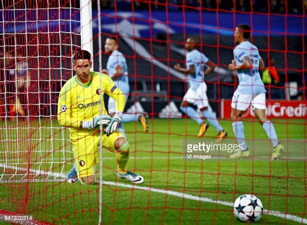 Goalkeeper Brad Jones looks to the ball in the net after 04 Manchester City during the UEFA Champions League group F match between Feyenoord...