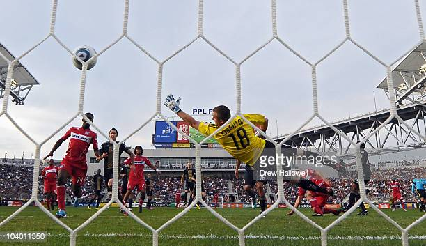 Goalkeeper Brad Knighton of the Philadelphia Union dives attempting to make a save, on a play that was whistled offside during the game against the...