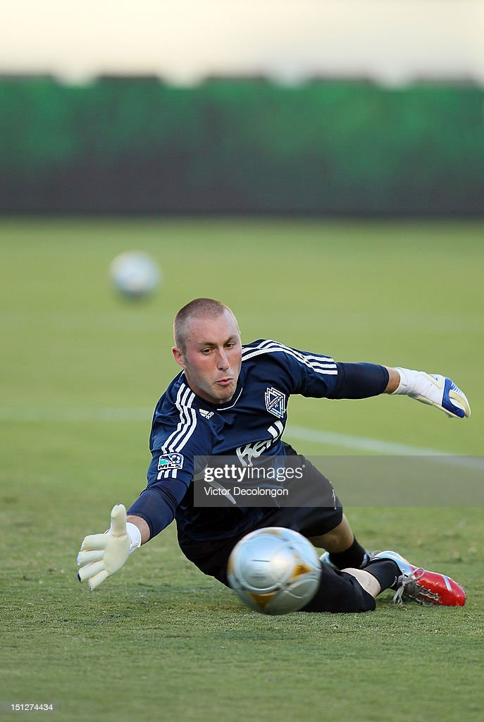 Goalkeeper Brad Knighton #18 of the Vancouver Whitecaps warms up prior to their MLS match against the Los Angeles Galaxy at The Home Depot Center on September 1, 2012 in Carson, California. The Galaxy defeated the Whitecaps 2-0.