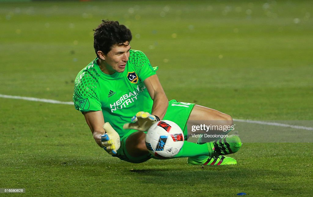 Goalkeeper Brian Rowe #12 of the Los Angeles Galaxy makes a save late in the first half during the MLS match against D.C. United at StubHub Center on March 6, 2016 in Carson, California. The Galaxy defeated United 4-1.
