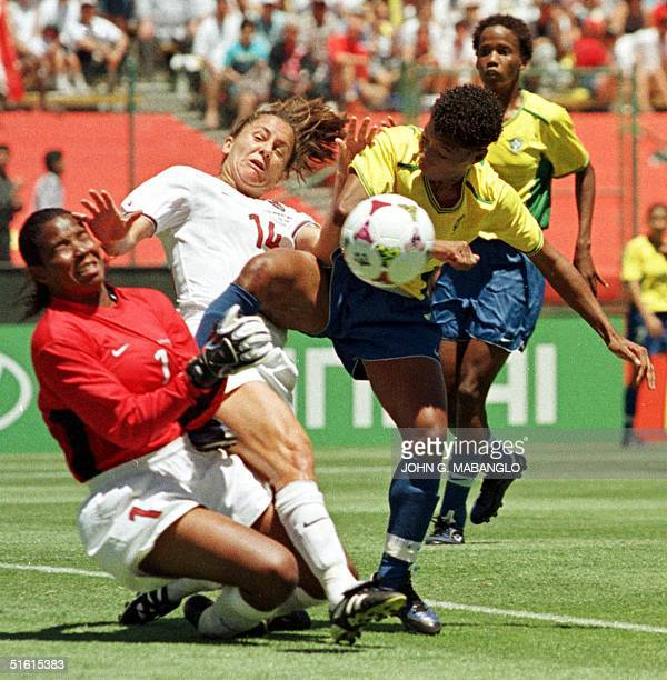 US goalkeeper Briana Scurry and teammate Joy Fawcett defend against a Brazilian attack by Pretinha on goal in the Women's World Cup semifinal match...