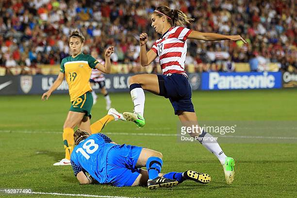 Goalkeeper Brianna Davey of Australia collects the ball as Alex Morgan of the USA leaps over her at Dick's Sporting Goods Park on September 19 2012...