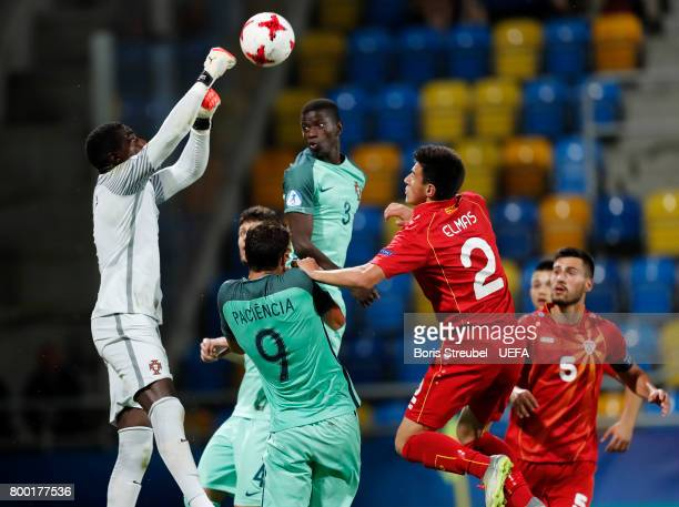 Goalkeeper Bruno Varela of Portugal saves the ball during the UEFA European Under21 Championship Group B match between Macedonia and Portugal at...