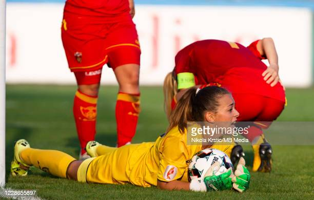 Goalkeeper Cabarkapa of Montenegro takes the ball during the UEFA Women's EURO 2022 Qualifier match between Montenegro and Germany at Pod Goricom on...