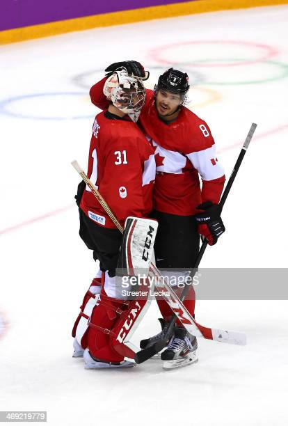 Goalkeeper Carey Price of Canada celebrates with teammate Drew Doughty after Canada beat Norway 3-1 during the Men's Ice Hockey Preliminary Round...