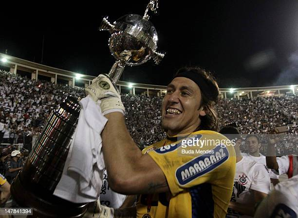 Goalkeeper Ca‡ssio of Corinthians celebrates a title with the trophy after the second leg of the final of the Copa Libertadores 2012 between Boca...
