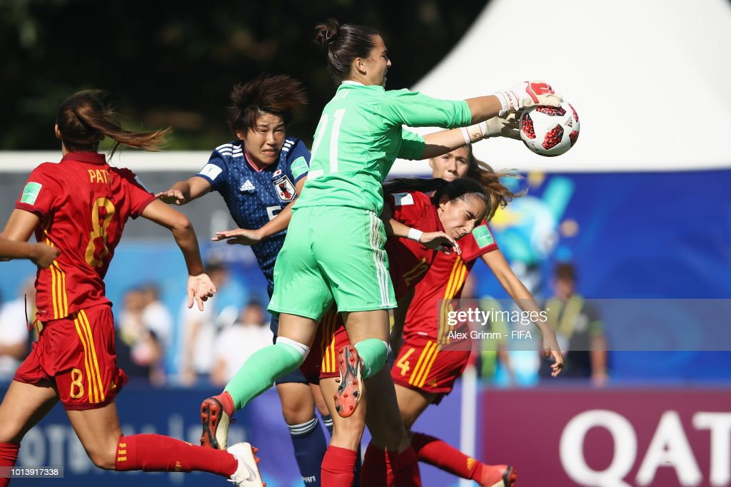 Goalkeeper Catalina Coll of Spain catches the ball ahead of Riko Ushijima of Japan during the FIFA U-20 Women's World Cup France 2018 group C match between Spain and Japan at Stade Guy-Piriou on August 9, 2018 in Concarneau, France.