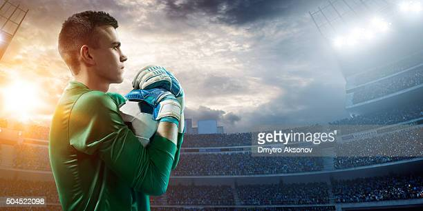 goalkeeper catches a ball - goalie goalkeeper football soccer keeper stock pictures, royalty-free photos & images