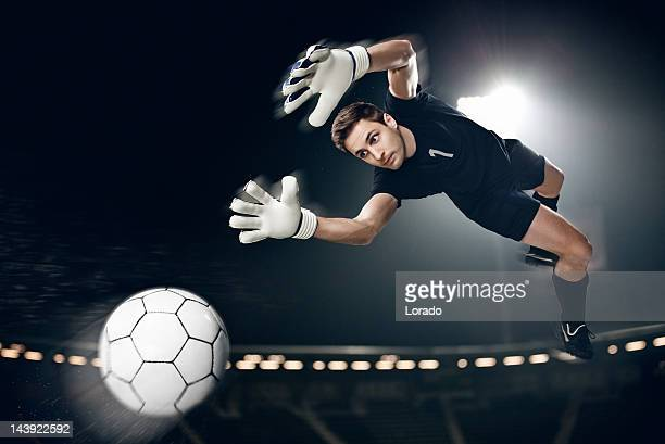 goalkeeper catching  ball in air