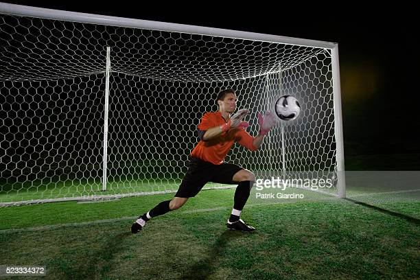 Goalkeeper catching soccer ball