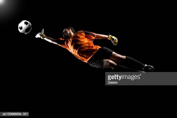 goalkeeper catching soccer ball - goalie goalkeeper football soccer keeper stock pictures, royalty-free photos & images