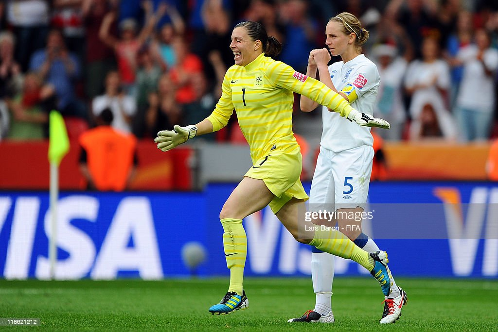 Goalkeeper Celine Deville of France celebrates next to Faye White, who missed the last penalty, after winning the FIFA Women's World Cup 2011 Quarter Final match between England and France at the FIFA Women's World Cup Stadium Leverkusen on July 9, 2011 in Leverkusen, Germany.