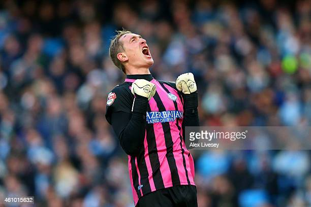 Goalkeeper Chris Kirkland of Sheffield Wednesday celebrates as his team take a 1-0 lead during the FA Cup Third Round match between Manchester City...