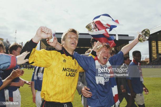 Goalkeeper Chris Woods and forward Mo Johnston of Rangers FC, celebrate with the trophy on the pitch after Rangers beat Aberdeen 2-0 at Ibrox Stadium...