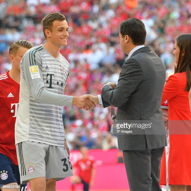 Goalkeeper Christian Fruechtl of Muenchen receives his medal after the Bundesliga match between FC Bayern Muenchen and VfB Stuttgart at Allianz Arena...