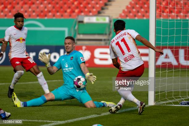 goalkeeper Christian Mathenia of 1FC Nuernberg and Heechan Hwang of RB Leipzig during the DFB Cup first round match between 1 FC Nuernberg and RB...
