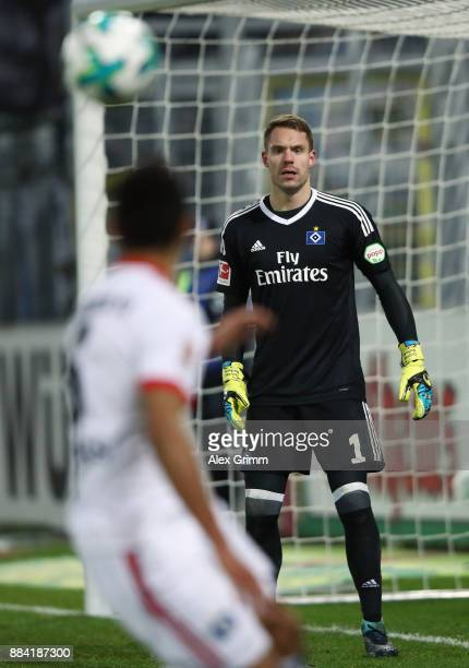 Goalkeeper Christian Mathenia of Hamburg watches team mates Douglas Santos control the ball during the Bundesliga match between SportClub Freiburg...