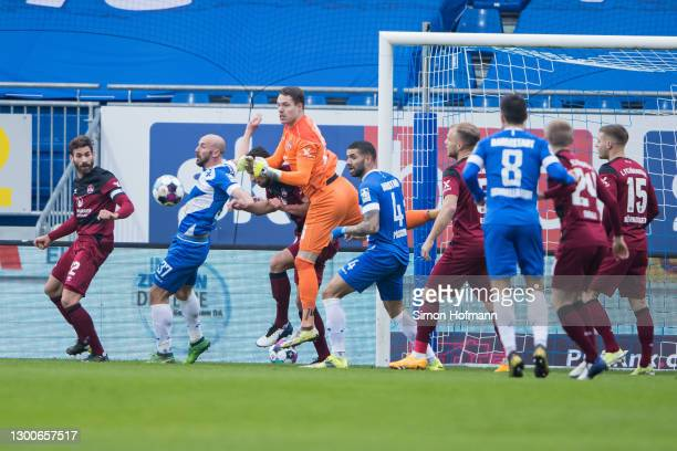 Goalkeeper Christian Mathenia of Nuernberg makes a save against Patrick Herrmann and Victor Palsson of Darmstadt during the Second Bundesliga match...