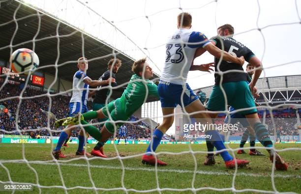 Goalkeeper Christian Walton and Dan Burn of Wigan Athletic fail to stop PierreEmile Hojbjerg of Southampton from scoring their first goal during The...