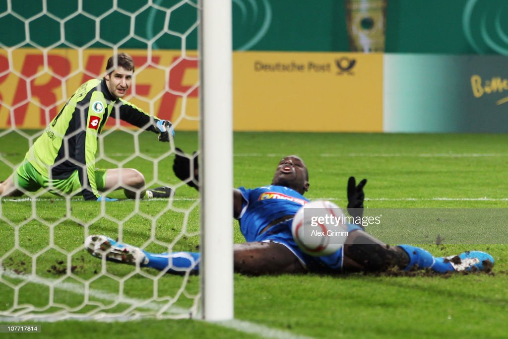 Goalkeeper Christofer Heimeroth (back) of M'Gladbach reacts as Demba Ba of Hoffenheim misses a goal during the DFB Cup round of sixteen match between 1899 Hoffenheim and Borussia M'Gladbach at the Rhein-Neckar Arena on December 21, 2010 in Sinsheim, Germany.
