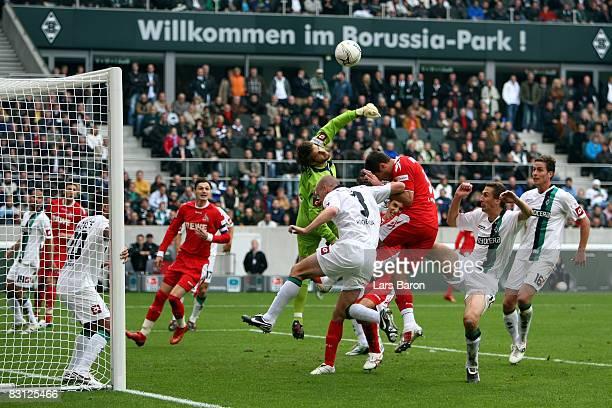 Goalkeeper Christopher Heimeroth blocks the ball infront of Youssuf Mohamad of Koeln during the Bundesliga match between Borussia Moenchengladbach...