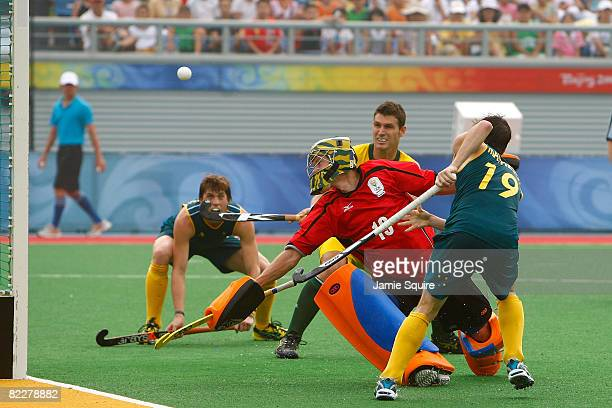 Goalkeeper Christopher Hibbert of South Africa fails to stop the goal by Eli Matheson of Australia during the men's pool hockey match at the Olympic...
