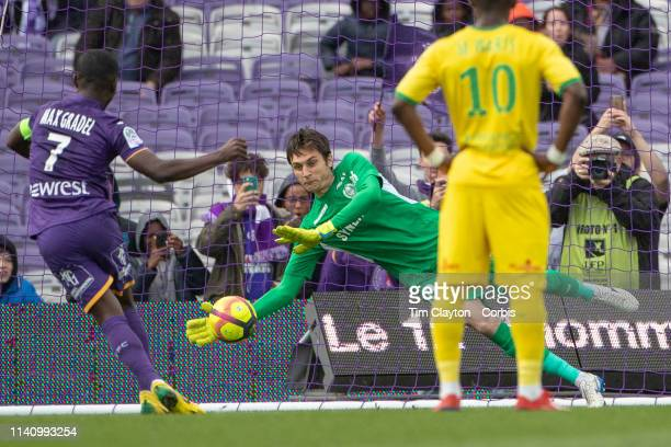 Goalkeeper Ciprian Tatarusanu of Nantes saves a penalty kick from Max Gradel of Toulouse during the Toulouse FC V Nantes French Ligue 1 regular...