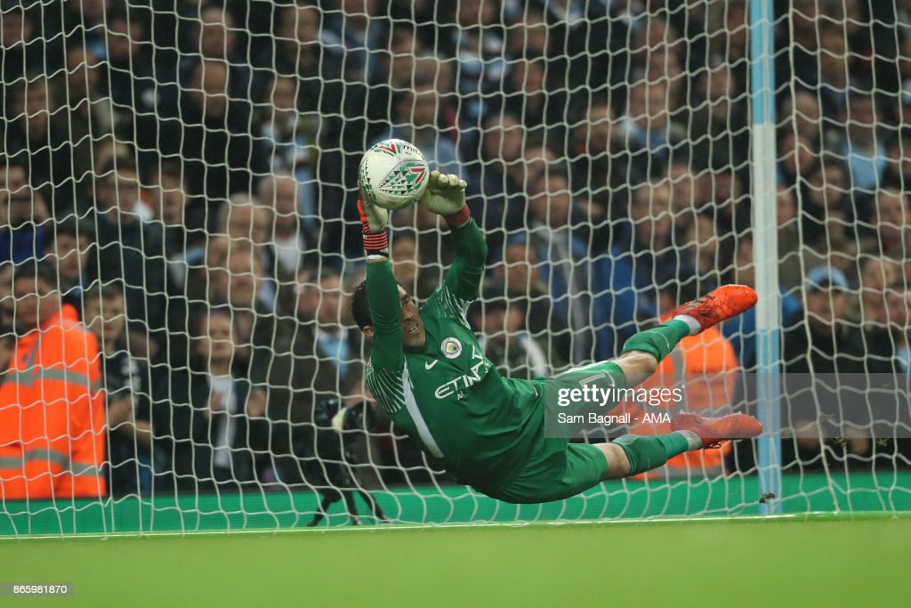 Goalkeeper Claudio Bravo Manchester City saves a penalty from Alfred NDiaye of Wolverhampton Wanderers during the penalty shoot out during the Carabao Cup Fourth Round match between Manchester City and Wolverhampton Wanderers at Etihad Stadium on October 24, 2017 in Manchester, England.