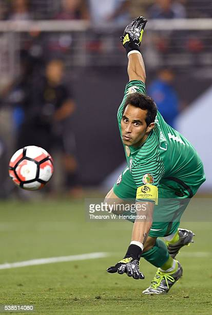 Goalkeeper Claudio Bravo of Chile dives for a shot that goes wide against Argentina during the 2016 Copa America Centenario Group match play between...