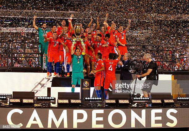 Goalkeeper Claudio Bravo of Chile lifts the trophy after the championship match between Argentina and Chile at MetLife Stadium as part of Copa...
