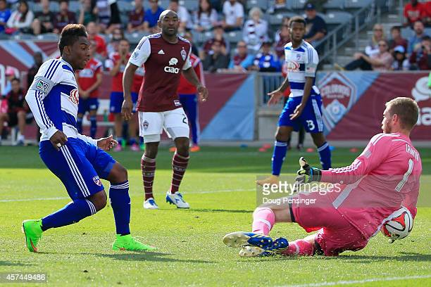Goalkeeper Clint Irwin of Colorado Rapids makes a save on a shot by Fabian Castillo of FC Dallas at Dick's Sporting Goods Park on October 18 2014 in...