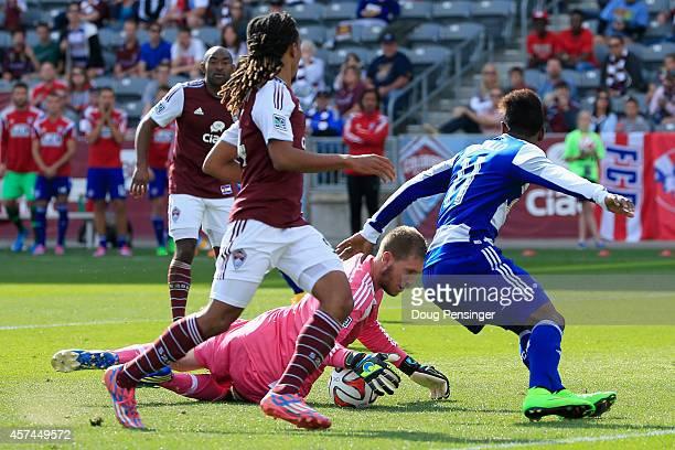 Goalkeeper Clint Irwin of Colorado Rapids makes a save on a shot by Fabian Castillo of FC Dallas as Marlon Hairston of Colorado Rapids follows the...