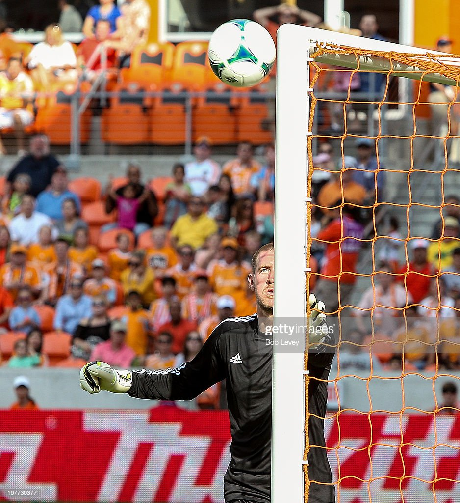 Goalkeeper Clint Irwin #31 of the Colorado Rapids watches the ball hit the upright against the Houston Dynamo at BBVA Compass Stadium on April 28, 2013 in Houston, Texas.