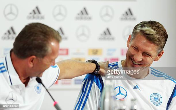 Goalkeeper coach Andreas Koepke and Bastian Schweinsteiger attend a Germany press conference at CommerzbankArena on September 1 2015 in Frankfurt am...