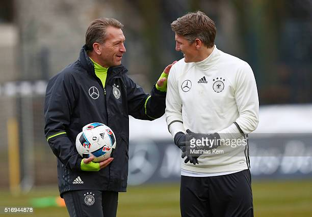 Goalkeeper coach Andreas Koepke of Germany and Bastian Schweinsteiger look on during a Germany training session ahead of their International frindly...