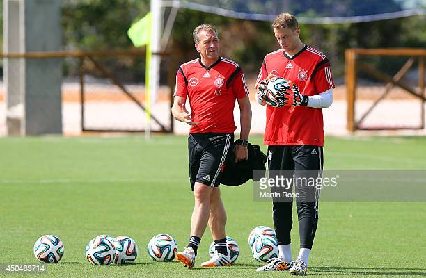 Goalkeeper coach Andreas Koepke talks to goalkeeper Manuel Neuer during the German National team training session at Campo Bahia on June 12 2014 in...