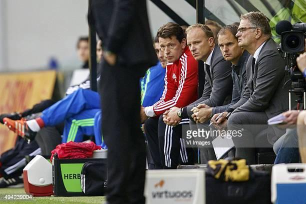 goalkeeper coach Carlo l Ami of Ajax assistant trainer Dennis Bergkamp of Ajax coach Frank de Boer of Ajax assistant trainer Hennie Spijkerman of...