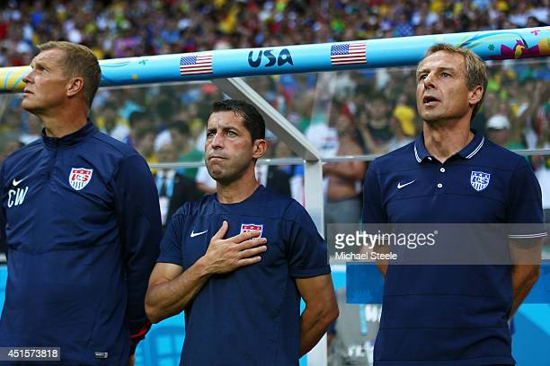 Goalkeeper coach Chris Woods, assistant coach Tab Ramos and head coach Jurgen Klinsmann of the United States look on during the National Anthem prior...
