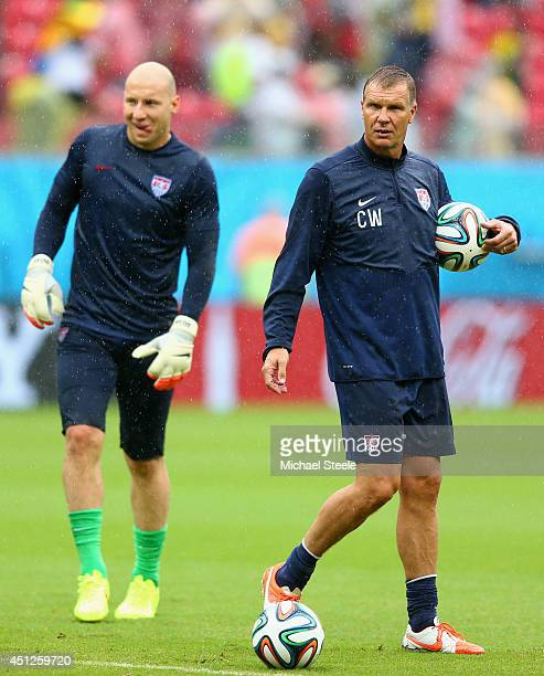 Goalkeeper coach Chris Woods of the United States looks on with Brad Guzan during the 2014 FIFA World Cup Brazil group G match between the United...