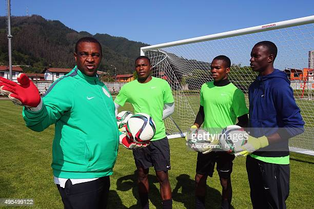 Goalkeeper coach Emeka Amadi talks to goalkeepers Akpan Udoh Chisom Chiaha and Amos Benjamin during a Nigeria training session during the FIFA U17...