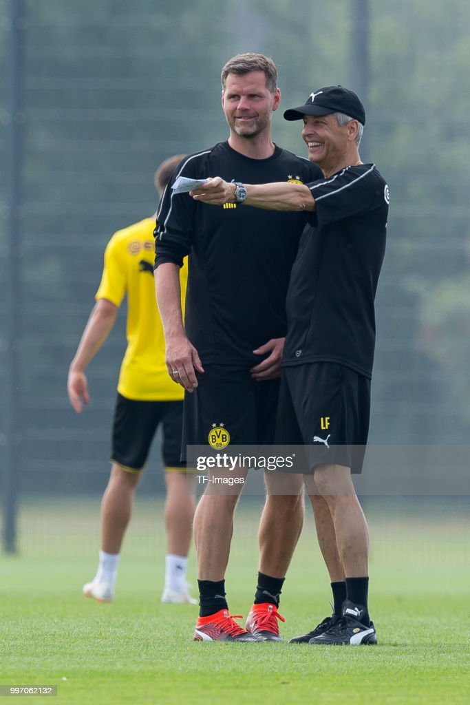 Goalkeeper coach Matthias Kleinsteiber of Dortmund and Head coach Lucien Favre of Dortmund laugh during a training session at BVB training center on July 12, 2018 in Dortmund, Germany.