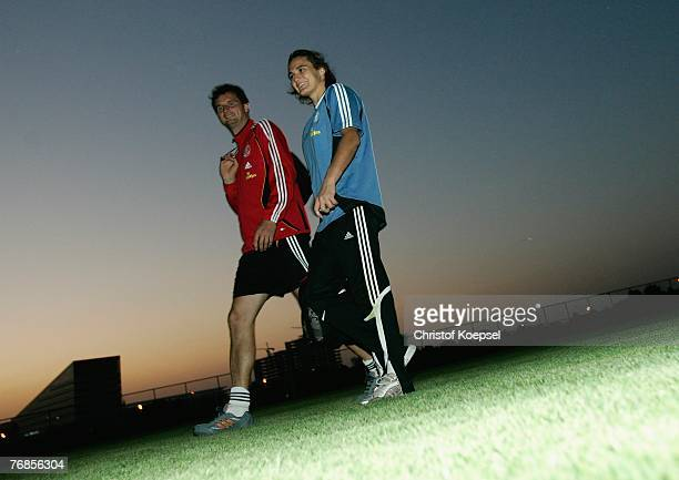 Goalkeeper coach Michael Fuchs and Nadine Angerer walk off the pitch after the Women's German National Team training session on the training ground...
